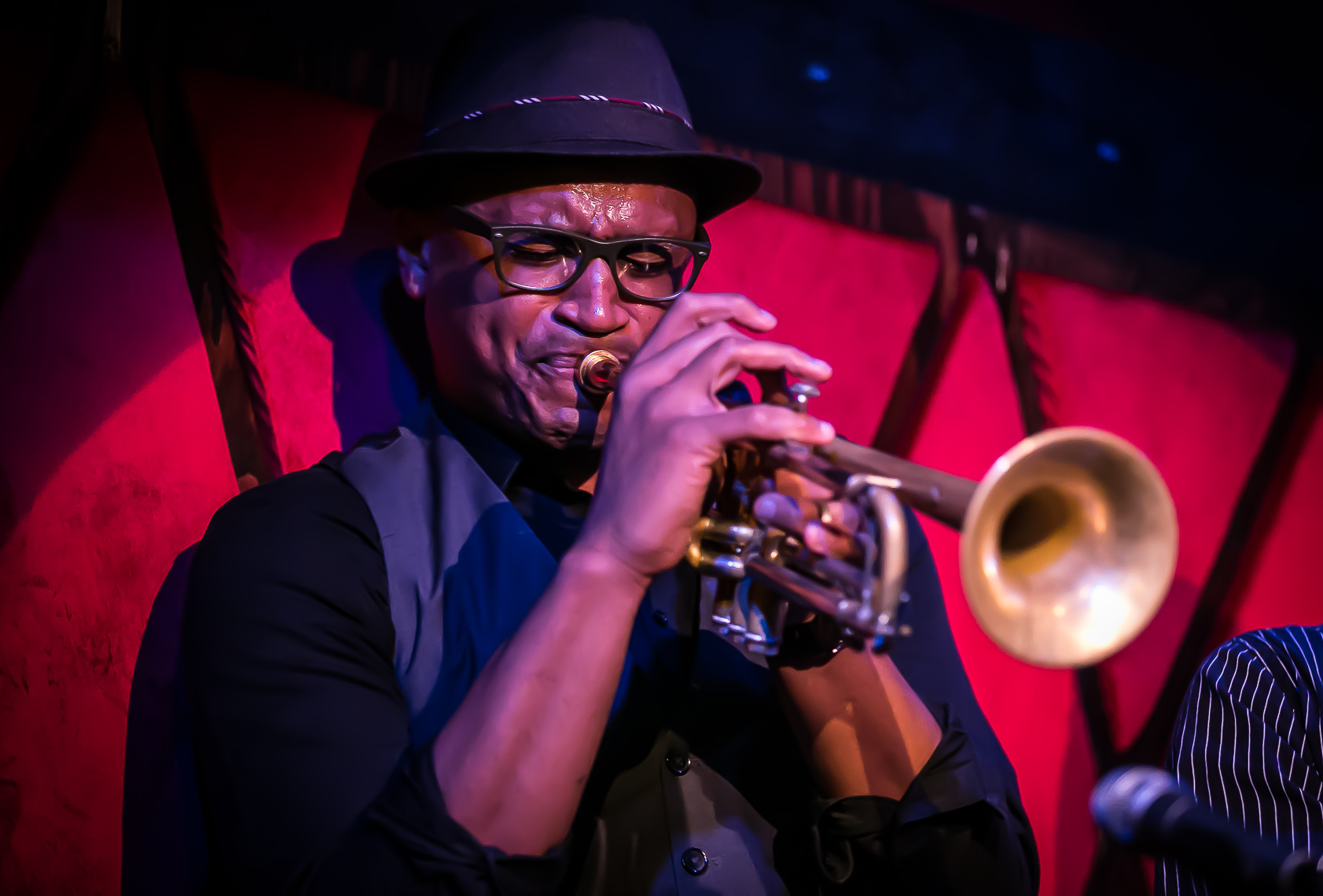 Jazz musician Bruce Harris on trumpet by music photographer Deborah Lowery